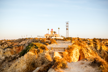 View on the lighthouse on the Ponta de Piedade on the south of Portugal Фото со стока
