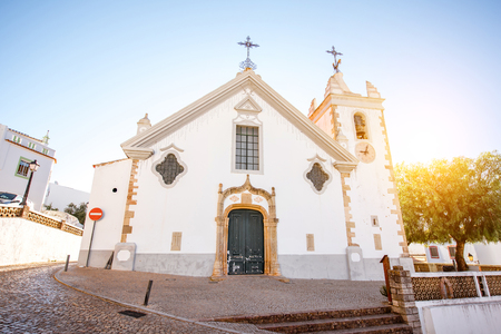 Typical village with white old church during the sunrise on the south of Portugal