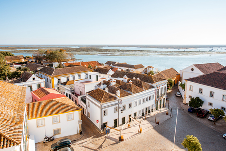 Top cityscape view on the old town with beautiful rooftops in Faro on the south of Portugal Foto de archivo - 90499102