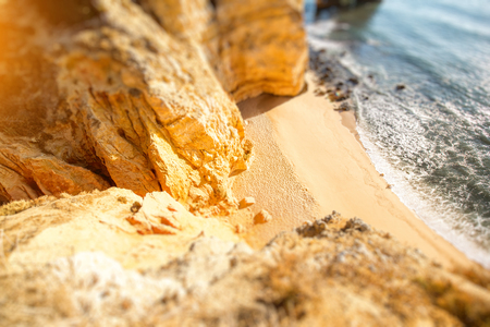 Top view on the beautiful sandy beach on the Ponta da Piedade near the Lagos city in Portugal. Tilt-shift image technic