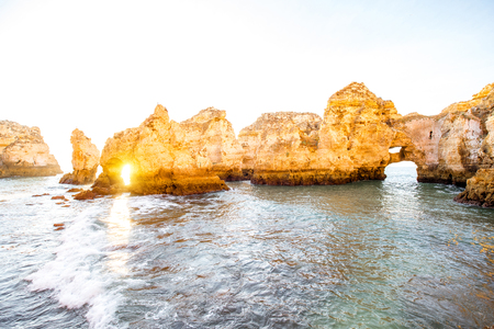 Beautiful landscape view on the rocky coastline on Ponta da Piedade during the sunrise near the Lagos city on the south of Portugal