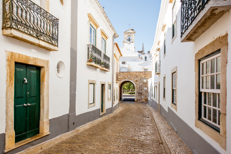 Street view with white houses in the old town of Faro on the south of Portugal