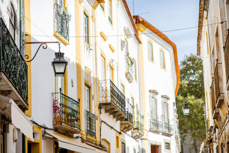 Street view with beautiful old residential buildings in Evora city in Portugal