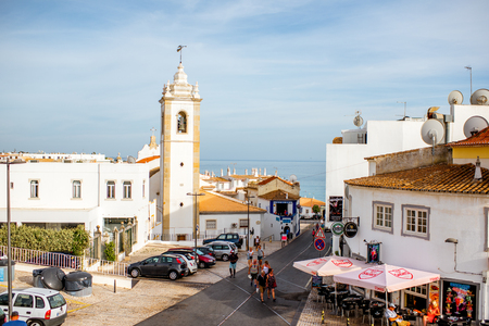 ALBUFEIRA, PORTUGAL - October 01, 2017: Cityscape view on the old town with beautiful white houses and church in Albufeira city on the south of Portugal