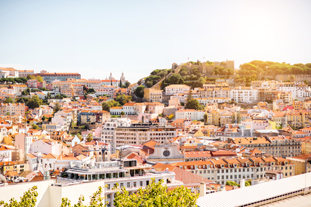 Cityscape view on the old town with castle hill during the sunny weather in Lisbon city, Portugal Stock fotó
