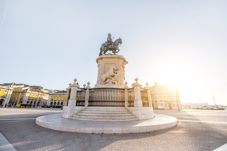 Morning view on the Commerce square with statue fo king Joseph in Lisbon city, Portugal