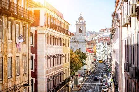 Street view with beautiful buildings in the old town of Lisbon city, Portugal Banco de Imagens