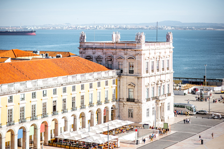 Top view on the Commerce square with Administration building tower in the centre of Lisbon city during the sunny day in Portugal