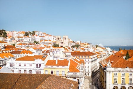 Cityscape view on the old town with Commerce square and Cathedral of saint Mary Major in Lisbon, Portugal