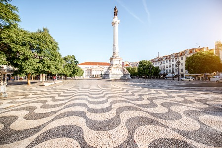 View on the Rossio square with column monument during the sunrise in Lisbon city, Portugal