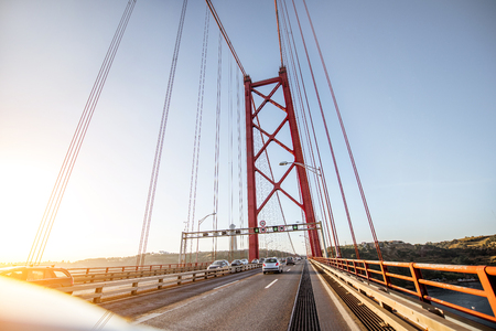 Driving on the famous 25th of April bridge in Lisbon city, Portugal