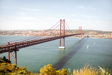 Landscape view on the Tagus river and the famous 25th of April Bridge in Lisbon city, Portugal 스톡 콘텐츠