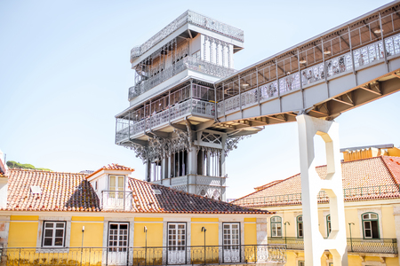 View on the old buildings with famous saint Justa metal lift during the sunny weather in Lisbon city, Portugal