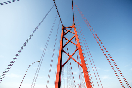 Close-up view on the construction of the famous 25th of April bridge in Lisbon city, Portugal