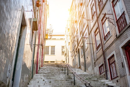 Beautiful street view with beautiful residential buildings in Mouraria district during the morning light in Lisbon city, Portugal Reklamní fotografie