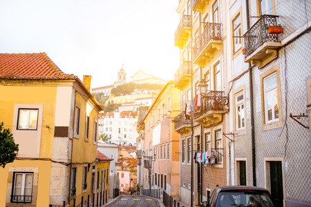 Beautiful street view with beautiful residential buildings in Mouraria district during the morning light in Lisbon city, Portugal Archivio Fotografico