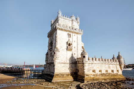 View on the fortified Belem tower on the coast of Lisbon city during the sunset light in Portugal