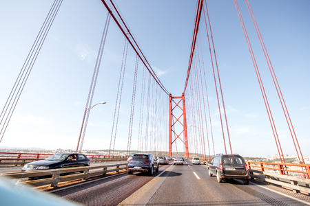 LISBON, PORTUGAL - September 28, 2017: Driving on the famous 25th of April bridge in Lisbon city, Portugal Stok Fotoğraf - 90560958