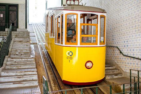 LISBON, PORTUGAL - September 28, 2017: Famous yellow funicular on the Bica street in Lisbon during the sunny day in Portugal Sajtókép