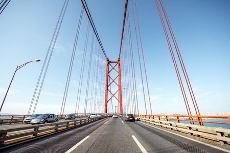 LISBON, PORTUGAL - September 28, 2017: Driving on the famous 25th of April bridge in Lisbon city, Portugal Stok Fotoğraf - 90560965