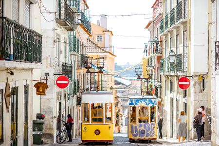 LISBON, PORTUGAL - September 28, 2017: Famous yellow funicular on the Bica street in Lisbon during the sunny day in Portugal Editorial