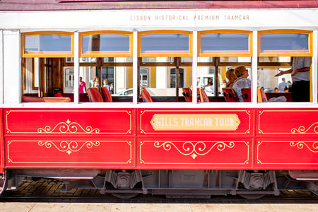 LISBON, PORTUGAL - September 27, 2017: Retro tourist tram with passengers in Lisbon city, Portugal Editorial