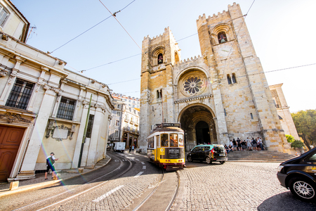 LISBON, PORTUGAL - September 28, 2017: Street view with famous old tourist tram full of people near the main cathedral in Lisbon city, Portugal Editorial