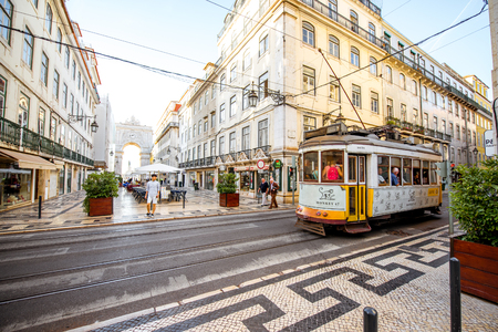 LISBON, PORTUGAL - September 28, 2017: Street view with famous old tourist tram full of people during the sunny day in Lisbon city, Portugal