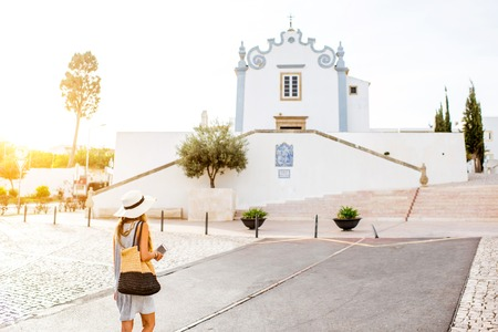 Young woman traveling in Albufeira town on the south of Portugal