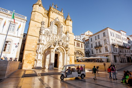 COIMBRA, PORTUGAL - September 26, 2017: View on the saint Croix church near the city hall building with people on the square in Coimbra city in the central Portugal Editorial