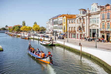 AVEIRO, PORTUGAL - September 26, 2017: View on the water channel with boats and colorful old buildings in Aveiro city in Portugal