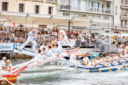SETE, FRANCE - July 30, 2017: Water jousting competition which lasted in Sete on the south of France. Jousting is a fight on the boat practised principally in France
