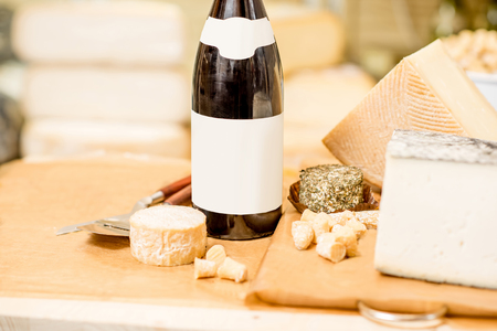 Cheese assortment with wine on the table in the cheese shop Stock Photo