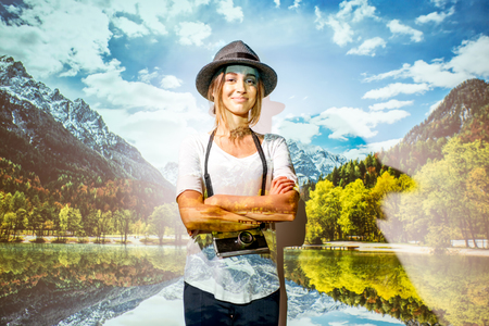 Portrait of a young woman traveler with projected image of a beautiful landscape view on the mountains and lake