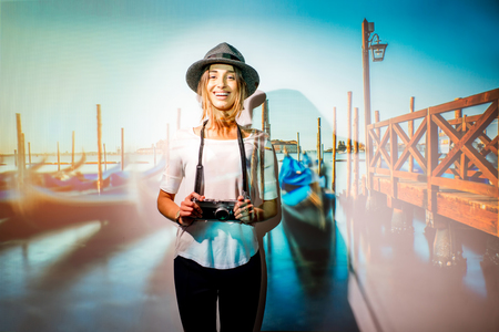 Portrait of a young woman traveler with projected image of landscape view on Venice city in Italy