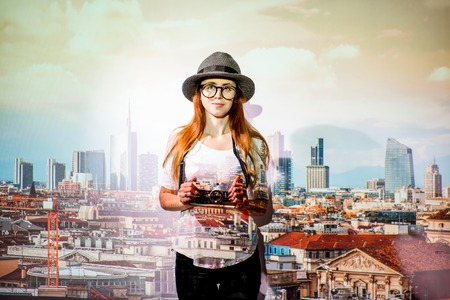 Portrait of a young woman traveler with projected image of Milan cityscape view in Italy