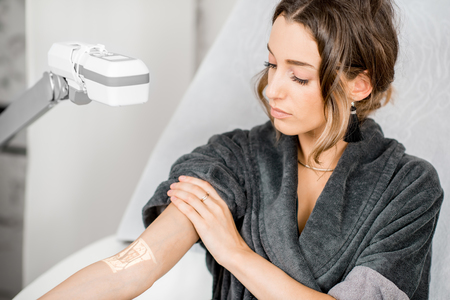 Young woman finding veins with vein scanner device for injection in medical resort Stock Photo