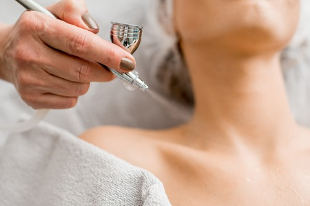 Professional splutter for hydration procedure spraying water on the neckline