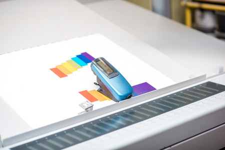 Spectrometer tool on the printing at the operating table of the printing plant