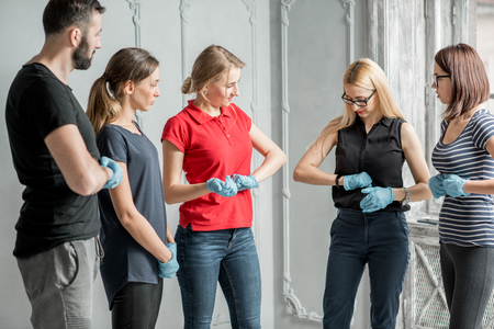 Instructor showing how to safe a life when the human is choked standing during the fisr aid training indoors Stock Photo