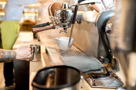 Close-up view on the professional coffee machine with cup in the cafe Stock Photo