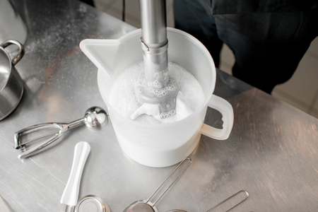 Mixing milk with sugar and cream for ice cream production