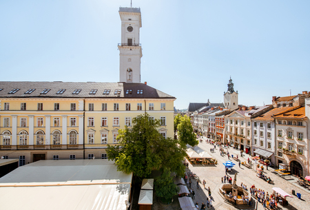 Cityscape view on the old town with beautiful buildings and town hall during the sunny weather in Lviv city in Ukraine