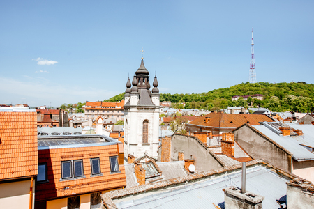 Cityscape view on the old town with church tower and High castle hill in Lviv city, Ukraine Stock Photo