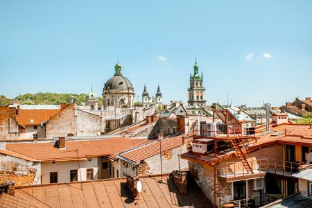 Cityscape view on the old town with Dominican church and Korniakt tower in Lviv city, Ukraine