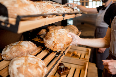 Breads on the wooden shelves of the bakery shop