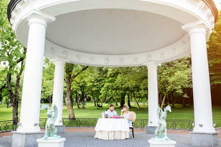 View on the beautiful royal alcove with couple having romantic breakfast in the garden 스톡 콘텐츠