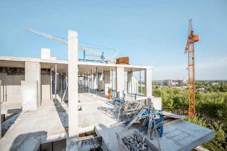 Residential building during the construction process during the sunny weather