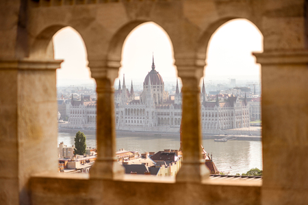 View on the Parliament building through the balustrade of Fishermans bastion in Budapest, Hungary