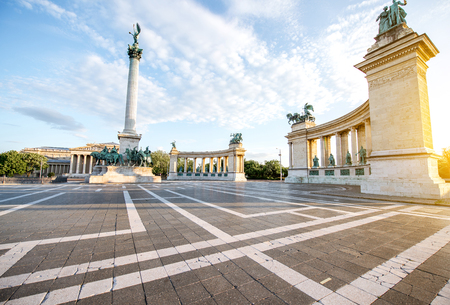 Morning view on the empty Heroes square with monument and column during the sunny weather in Budapest, Hungary